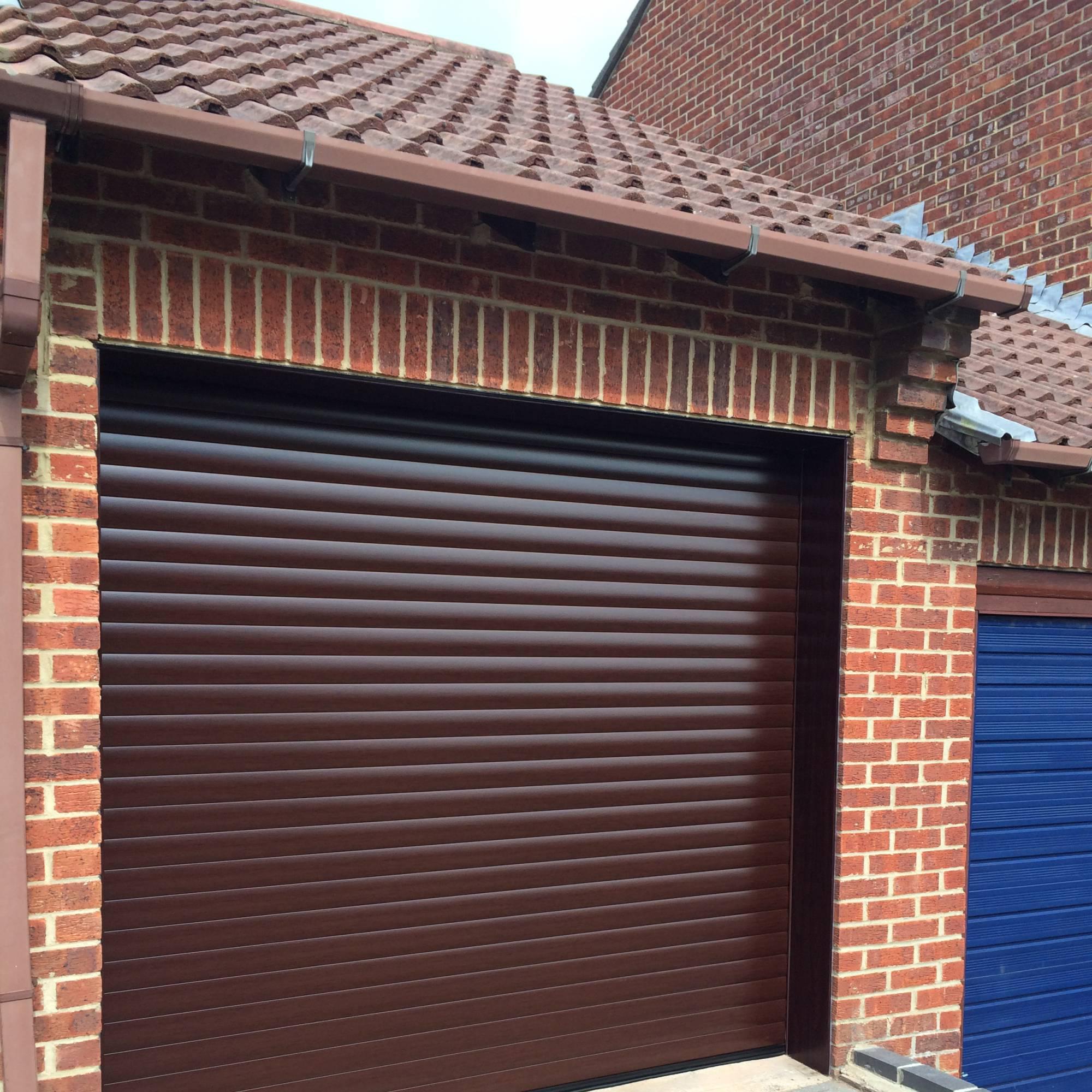 rollmatic hormann garage doors in rosewood. Black Bedroom Furniture Sets. Home Design Ideas