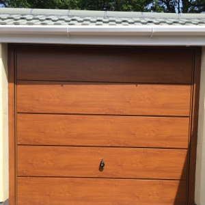 Golden Oak Hormann Garage Doors in Horizontal Decograin finish