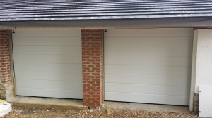 Two new fully insulated Teckentrup sectional garage doors